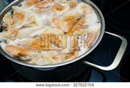 View From Above Of Jiaozi Boliling In The Pot - It Is A Chinese Dumpling, Commonly Eaten In China An