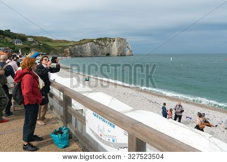Etretat, Seine-maritime / France - 14 August 2019: Many Tourists Enjoy A Day At The Rocky Beaches Of