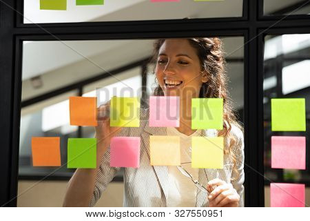 Businesswoman Writes Creates Personal Tasks List On Sticky Notes