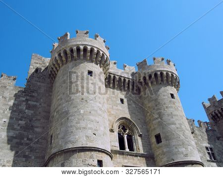 The Front And Entrance To The Medieval Palace Of The Grandmasters In Rhodes Town Against A Blue Summ