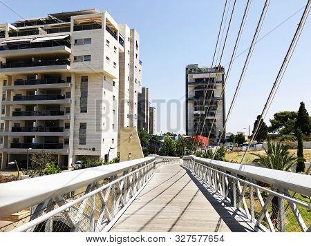 Rishon Le Zion, Israel  October 07, 2019: Residential Buildings, Plants And Bridge  In Rishon Le Zio