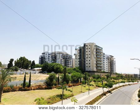 Rishon Le Zion, Israel  October 07, 2019: Residential Buildings , Plants And Street   In Rishon Le Z