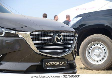 Kharkov, Ukraine - August 31, 2019: Mazda Logo Badge And Car Grill On Mazda Cx-9 Luxury Vehicle. Maz