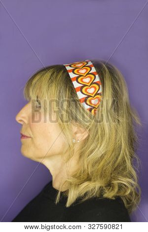 Portrait Of Blond Woman With Hippie Look