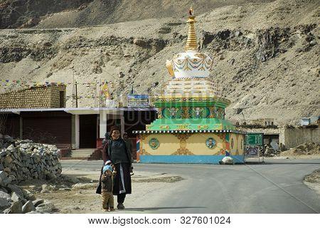 Tibetan And Indian People Walking Beside Road Of Tsati Village On Khardung La Pass While Winter Seas