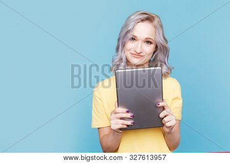 Cute Female In The Yellow T-shurt Holding Tablet Isolated.