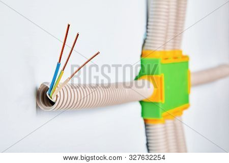 The Conduit Is Connected To The Electrical Distribution Box Of The Household Wiring, The Ends Of The