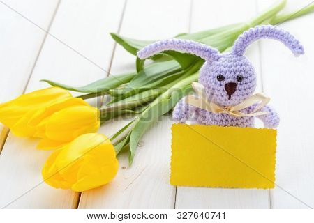 Spring Tulips, A Handmade Bunny And A Yellow Card On The Light Wooden Background, Close-up. Place To