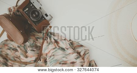 Woman Clothing And Accessories Placed On A Wooden Background