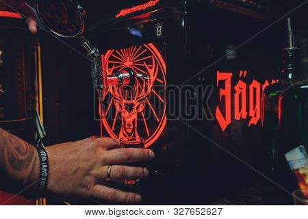 Ufa, Russia, Harats Pub, 15 November, 2018: Jagermeister Alcohol Drinks In Bar. Bartender Pours A Gl