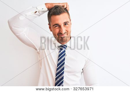 Young handsome elegant business man over isolated background confuse and wonder about question. Uncertain with doubt, thinking with hand on head. Pensive concept.