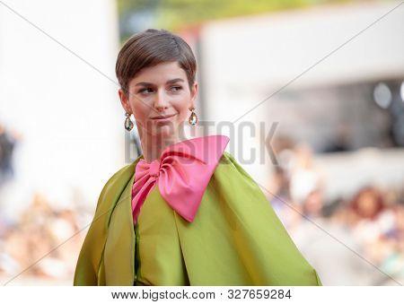 Mariana Di Girolamo walk the red carpet ahead of the