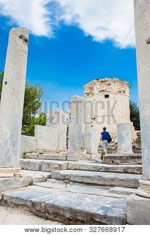 Athens, Greece - April, 2018: Tourist Visiting The Tower Of The Winds Or The Horologion Of Androniko