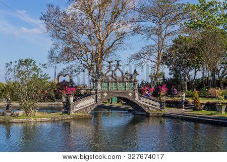 Bali, Indonesia - 17 September 2019: People visiting the gardens of Tirtagangga Water Palace in Bali, Indonesia