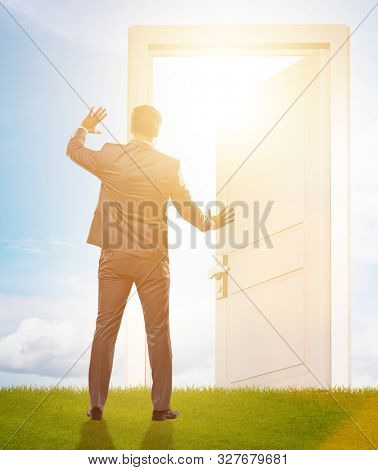 Businessman standing in front of door into future