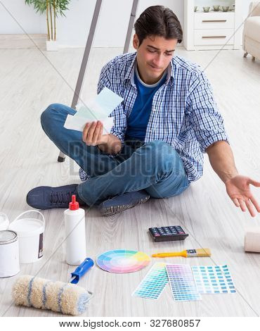Young man overspending his budget in refurbishment project poster