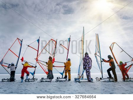 A Group Of Children At A Windsurfing Training Session On The Ice Of The Frozen Sea.