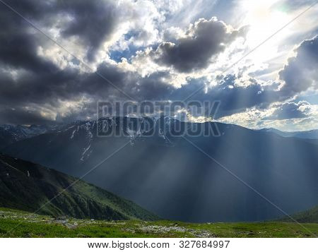 Beautiful Mountain Scenery With The Rays Of The Sunset, Background For Outdoor Travel.