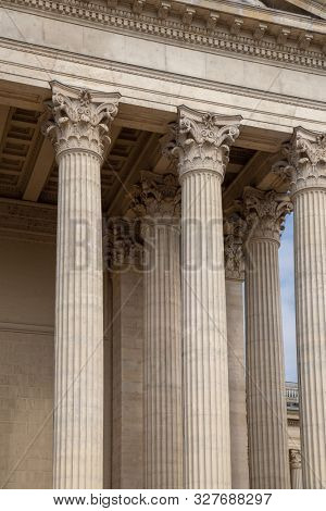 Vintage Old Justice Courthouse Column. Neoclassical colonnade with corinthian columns as part of a public building resembling a Greek or Roman temple poster