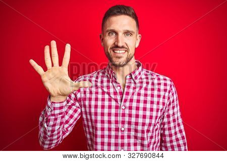 Young handsome man over red isolated background showing and pointing up with fingers number five while smiling confident and happy.