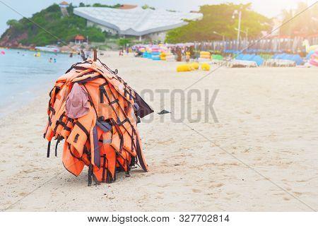 Life Jacket Hang On Beach With Copy Space At Koh Larn Pattaya