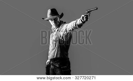 Man Wearing Cowboy Hat, Gun. West, Guns. Portrait Of A Cowboy. Owboy With Weapon On Red Background.