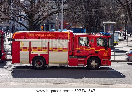 Stockholm, Sweden - April 18, 2019: Red Scania Fire Truck For Emergency Situations On The Streets Of