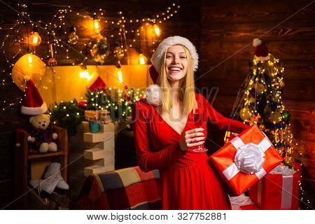 Celebrate Christmas. Woman Elegant Girl Red Dress Celebrate Christmas. Girl Near Christmas Tree Wint