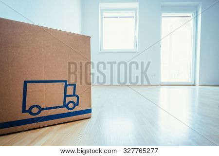 Move. Cardboard, Boxes For Moving Into A New, Clean And Bright Home. Clean And Sunny Room.