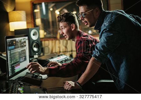 Sound engineer working in a music studio