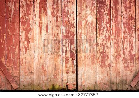 Vintage wood background. Grunge wooden weathered oak or pine textured planks. Aged brown or red color. An old worn barn or antique wooden fence with chipped red paint