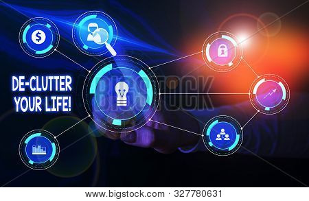 Handwriting text De Clutter Your Life. Concept meaning remove unnecessary items from untidy or overcrowded places Woman wear formal work suit presenting presentation using smart device. poster