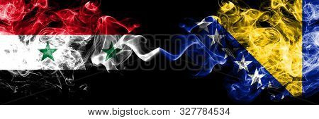 Syria Vs Bosnia And Herzegovina, Bosnian Smoke Flags Placed Side By Side. Thick Colored Silky Smoke