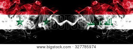 Syria Vs Iraq, Iraqi Smoke Flags Placed Side By Side. Thick Colored Silky Smoke Flags Of Syrian And