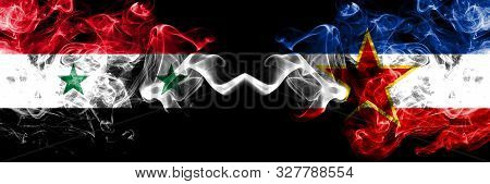 Syria Vs Yugoslavia Smoke Flags Placed Side By Side. Thick Colored Silky Smoke Flags Of Syrian And Y