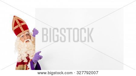 Sinterklaas or saint Nicholas pointing to blank cardboard. isolated on white background. Dutch character of Santa Claus