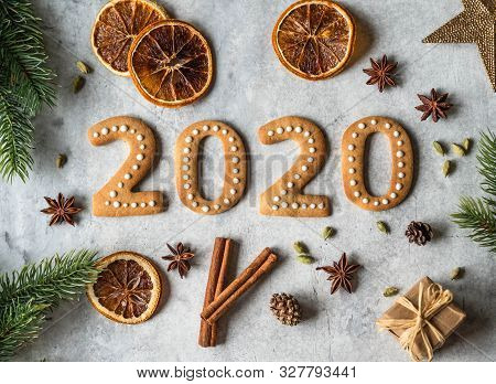 Ginger Biscuits Of The Form Of Numbers And 2020 New Year Ginger Cookies On Grey Background. Top View