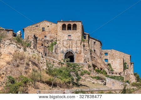 Panoramic View Of Famous Door In Civita Di Bagnoregio With Tiber River Valley, Lazio, Italy.