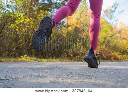 Woman Runs In The Forest. Close-up Of Sneakers. Helathy Lifestyle.
