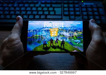 Kostanay, Kazakhstan, October 15, 2019.a Man Holds A Mobile Phone With A Screensaver Of The Popular