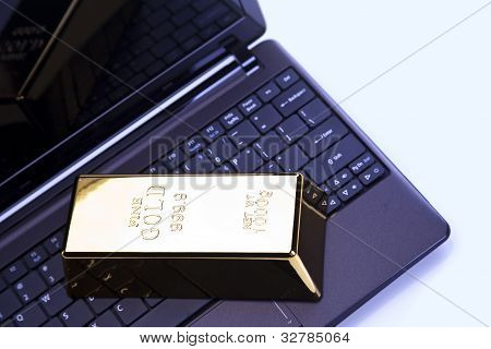Gold bars on laptop