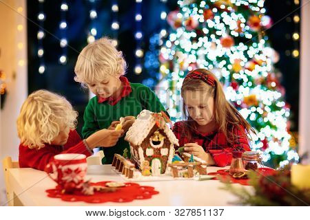Kids Baking Gingerbread House. Christmas At Home.