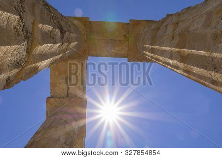 Ancient Temple Of Zeus Remains Of Columns Towering Above Into Sunburst And Lensflare Believed To Hav