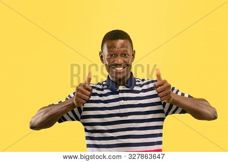 Happy Young African-american Man Isolated On Yellow Studio Background, Facial Expression. Beautiful
