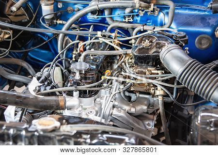 Close-up Of A Vintage Car Engine With Carburetor Brought For Repairs