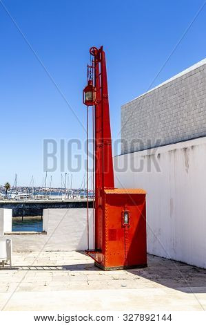 Cascais - August 14, 2019: View Of An Old Red Lighthouse Beacon, An Exhibit Of The Lighthouse Museum