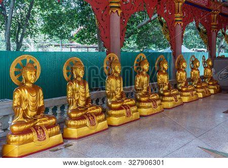 Bang Saen, Thailand - March 16, 2019: Wang Saensuk Buddhist Monastery. Line Of Golden Statues Of Bod