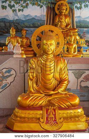 Bang Saen, Thailand - March 16, 2019: Wang Saensuk Buddhist Monastery. Golden Bodhisattva Statue Wit
