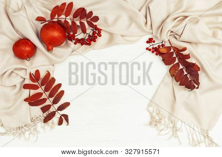 Autumn Background With Rowan Leaves Red Color And Rowanberries On Soft Autumnal Woman Clothing Scarf