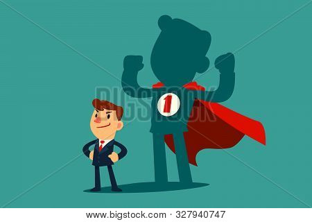 Confident Businessman Standing In Front Of His Shadow Wearing Red Cape As A Superhero. Business Ambi